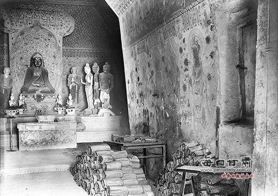 莫高窟 斯坦因 世界/斯坦因于1907年拍摄的莫高窟藏经洞外观。(资料图片敦煌研究院...