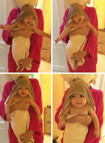 张梓琳抱女儿合影 一只美人鱼一只小胖鱼