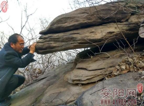 林州牧羊人山上发现巨石 能随风起舞却掉不下来