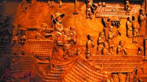 红木家具上雕刻清明上河图