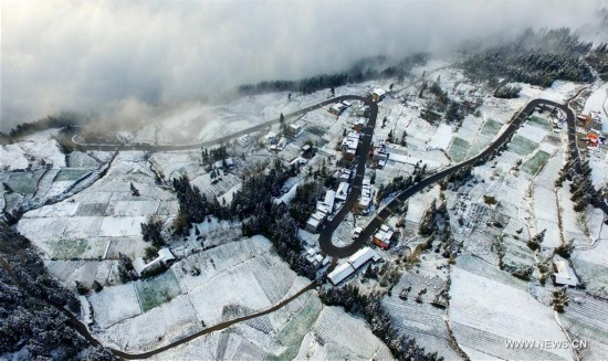 Sea of clouds seen over snow-covered mountains in Hubei