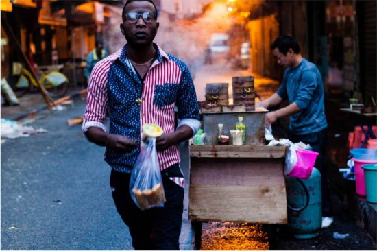 "An African student buys breakfast at a stall in the ""African Street"