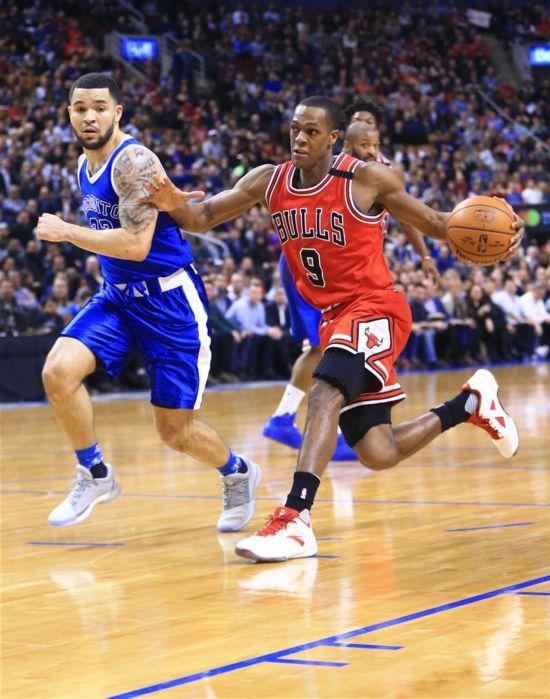 NBA常规赛:猛龙主场122-120险胜公牛(组图)