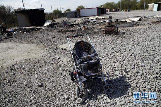 法国一难民营疑遭人为纵火致10余人受伤