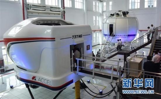 (图文互动)(1)国产首台D级飞行模拟机在天津交付使用