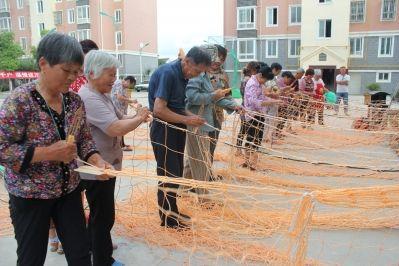 海安镇海村组织渔民开展编制渔网比赛增长技能