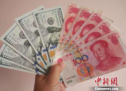 人民币对美元升破6.5去年底换2万美元现亏9000元