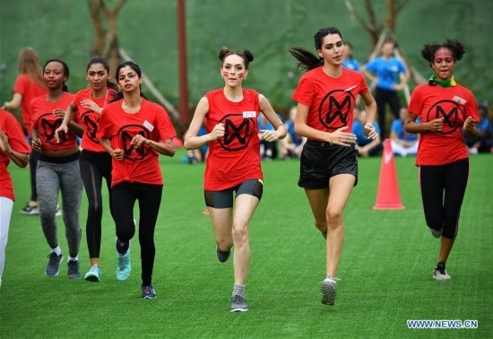 67th Miss World Competition contestants attend sports games in S China