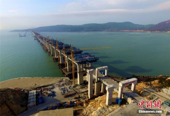 China's first cross-sea rail-road bridge takes shape