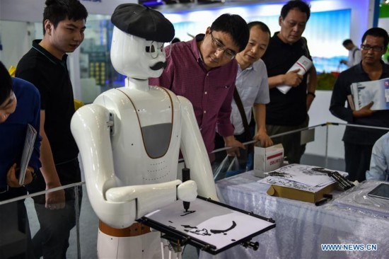 A robot artist with moustache and beret (People's Daily)