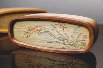 梁平竹帘蓝牙音箱系列融合了木艺、竹艺和传统绘画
