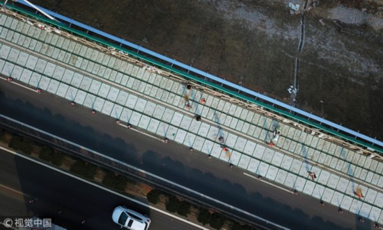 A photo shows the photovoltaic highway on Jinan City Ring Expressway in Shandong Province on November 30, 2017. [Photo: VCG]