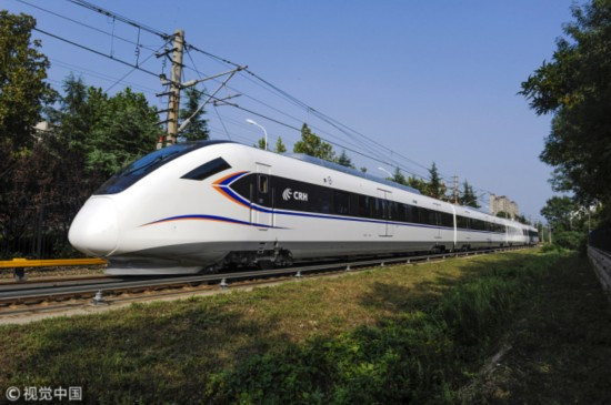 A CRH bullet train runs on a railway track. [File Photo: VCG]