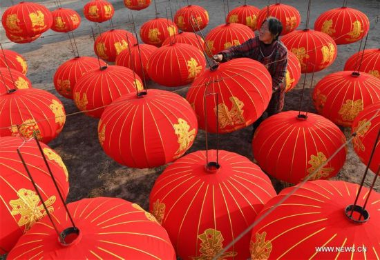 Workers prepare lanterns for upcoming new year in China's Shanxi