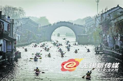 无锡举办古运河皮划艇赛 公益第一比赛第二