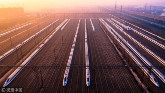 Photo shows high-speed trains at a maintenance base in Wuhan, Hubei Province on December 5, 2014. [Photo: VCG]