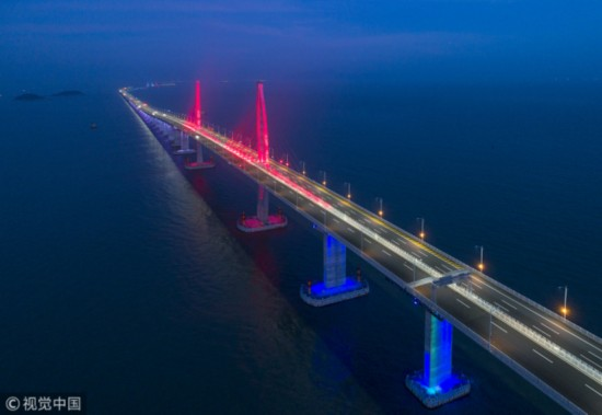 The Hong Kong-Zhuhai-Macao Bridge is lit up on January 3, 2018 after major works of the world's longest cross-sea bridge was completed by the end of 2017. [File Photo: VCG]