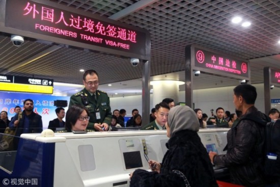 Police officers receive foreign citizens at an international airport in the southwestern Chinese city of Chengdu, December 14, 2017. [Photo: VCG]