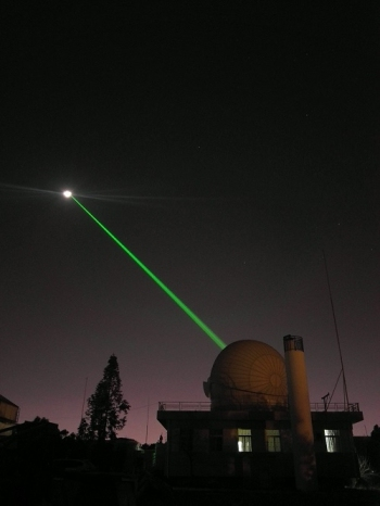 The applied astronomy group from the Yunnan Observatories accomplishes a successful Lunar Laser Ranging (LLR), with a 1.2-meter telescope laser ranging system, January 22, 2018. [Photo: Chinese Academy of Sciences]