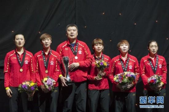 乒乓球团体世界杯:中国男队女队夺冠拾号足球场图片