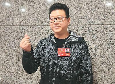 全国政协委员丁磊用先进的包装手段讲好中国故事