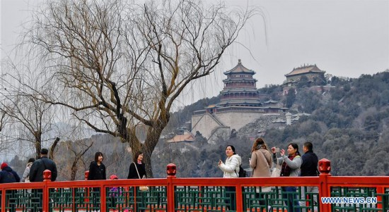 People enjoy leisure time at Summer Palace in Beijing