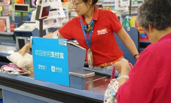 沃尔玛部分门店暂停使用支付宝 专家:有损公平交易