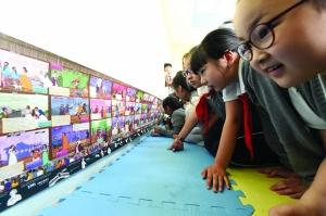 南图将展出神奇墙书:2.6米长 含38部莎士比亚戏剧