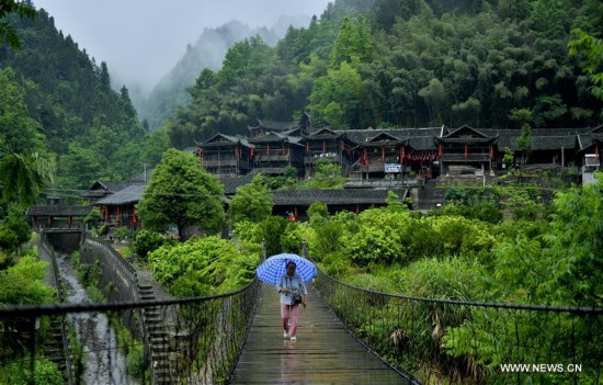 In pics: ancient stilt houses of Tujia