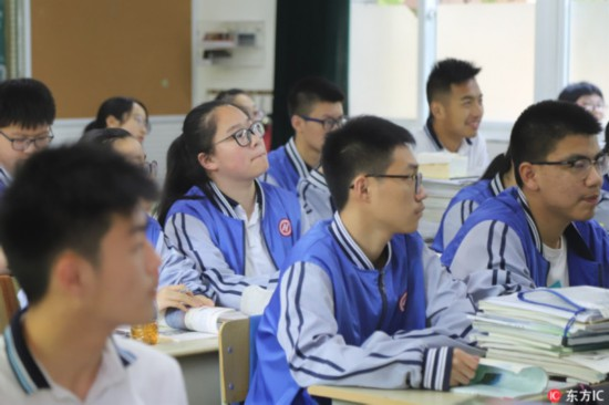 Students attend class in a classroom equipped with a facial-recognition camera at Hangzhou No. 11 High School, in Hangzhou, Zhejiang Province, on May 15, 2018. [Photo: IC]