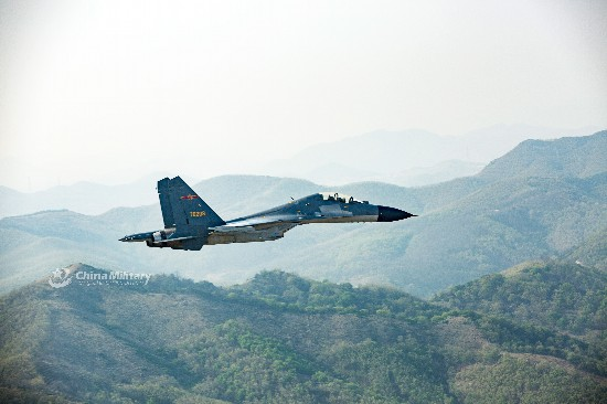 J-11B fighter jets fly through valley