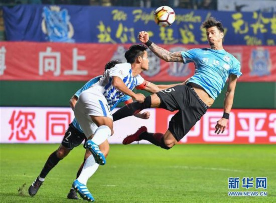 Jose Fonte (in blue) [Photo: Xinhua]