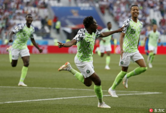 Nigeria's Ahmed Musa, centre, celebrates after scoring his team's first goal during the group D match between Nigeria and Iceland at the 2018 soccer World Cup in the Volgograd Arena in Volgograd, Russia,June 22, 2018. [Photo: IC]