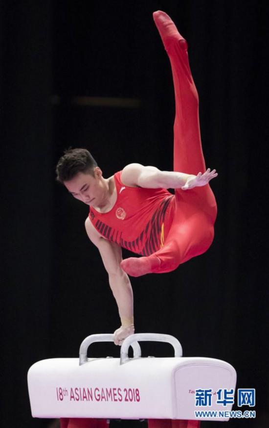 中国队获得体操男子团体金牌