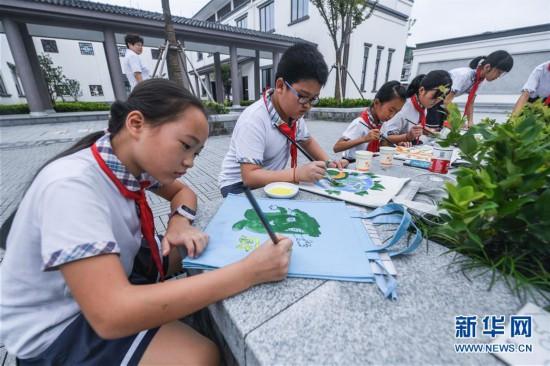 """(教育)(1)浙江湖州:""""环保小卫士""""参加环保主题活动"""
