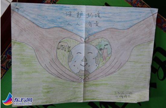 """图片说明:学生的手绘画""""保护环境人人有责""""图片"""