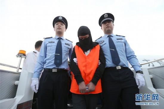 (法治)(1)17名外逃经济犯罪嫌疑人被押解回国