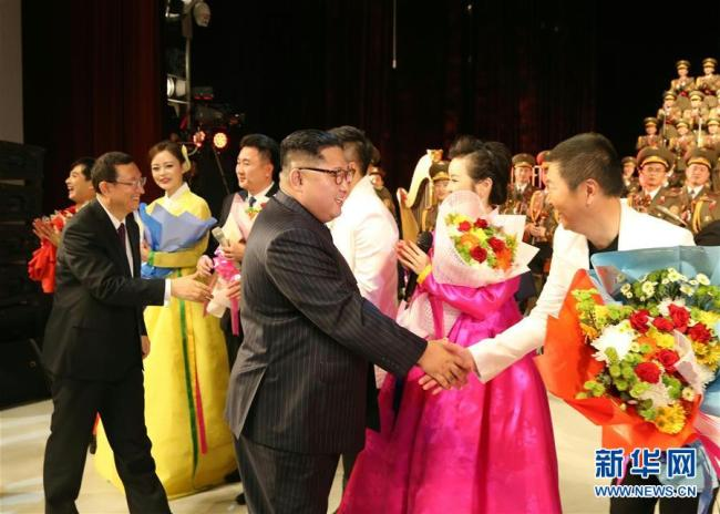 Kim Jong Un, chairman of the Workers' Party of Korea (WPK) and chairman of the State Affairs Commission of the Democratic People's Republic of Korea (DPRK), shakes hands with artists from China and the DPRK following a joint performance in Pyongyang on Saturday, November 3. [Photo: Xinhua]