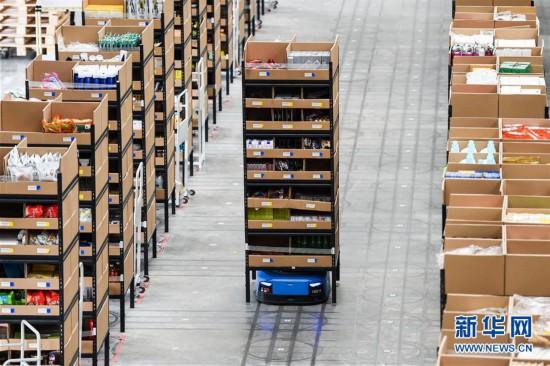 (经济)(2)江苏无锡:智能机器人拣选包裹效率高