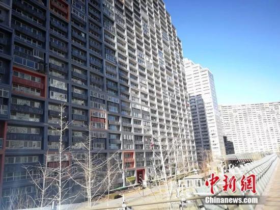 2018年12月,北京像素小区,楼房窗户密密麻麻。<a target='_blank'  data-cke-saved-href='http://www.chinanews.com/' href='http://www.chinanews.com/' ><p style=