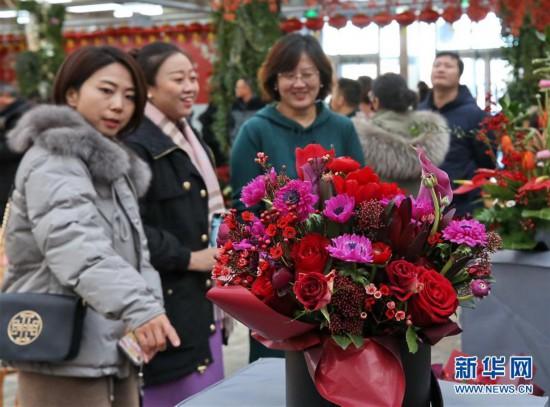 (社会)(1)北京:年宵花卉迎春节