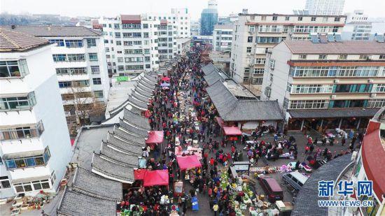 (社会)(1)赶大集 办年货 迎新春