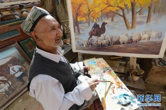 (社会)(1)农民画家阿卜力?#22235;?#36861;梦六十载