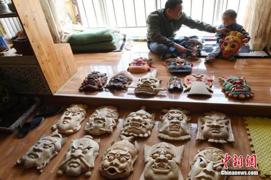 甘肃民间艺人17年间制作2000多张傩面具金猎猎头公司