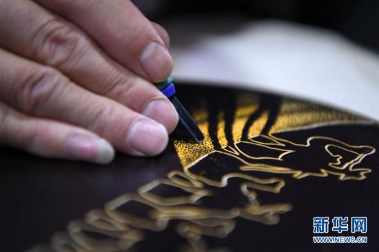 (图片故事)(1)用木刻画弘扬敦煌文化