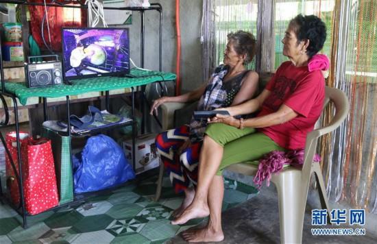 """(国际·图文互动)(3)通讯:中国国家电网""""光明乡村""""项目为菲律宾偏远山区带来光明"""