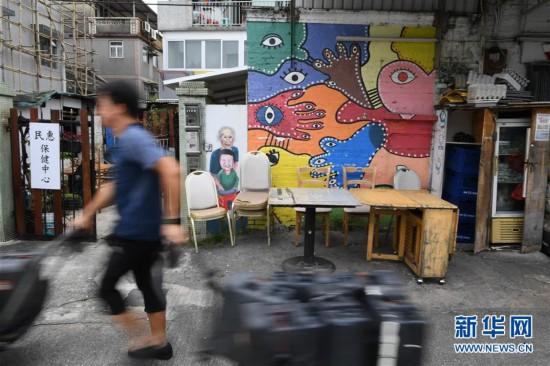 (港澳台·香港故事·图文互动)(5)香港锦田壁画村:200名义工绘就爱的画卷