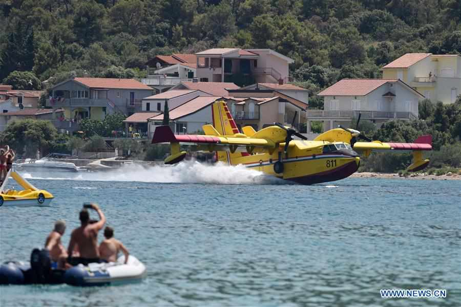Canadair fire-fighting plane demonstrates water-taking maneuvers in Croatia