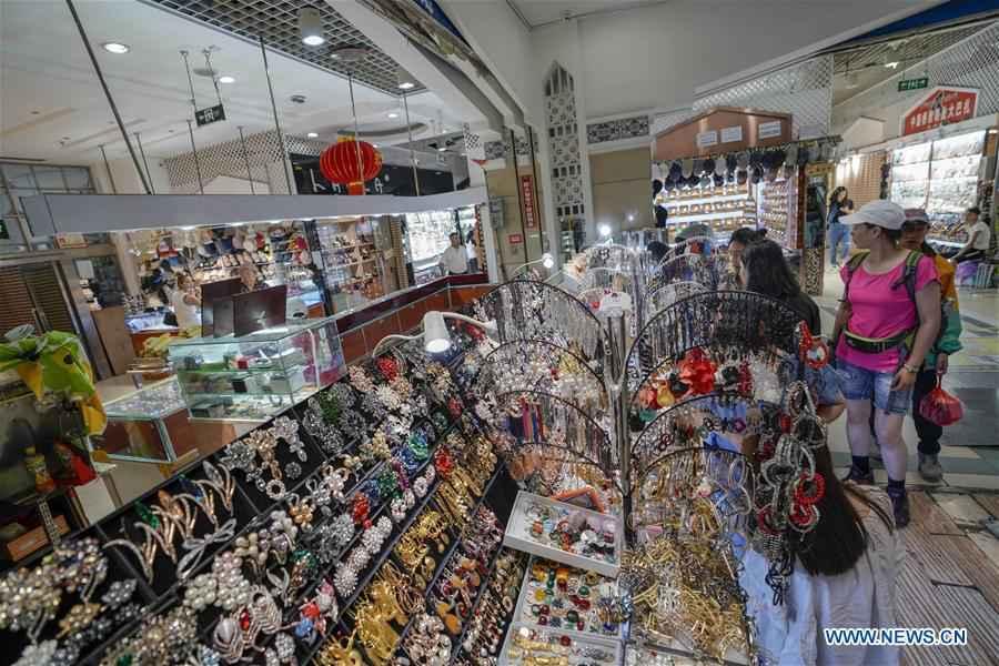 Int'l Grand Bazaar in Urumqi sees nearly 80,000 tourist trips during rush season