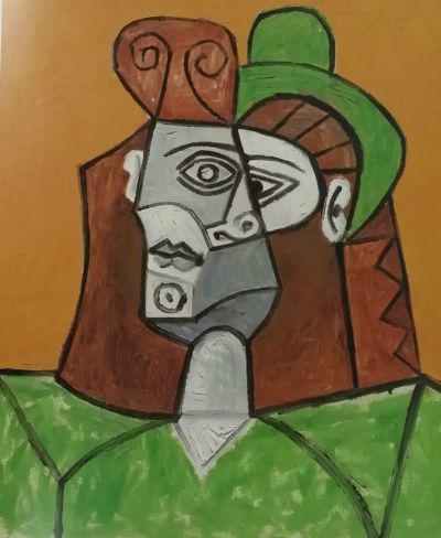 毕加索《戴绿帽子的女人》